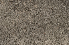 Gray house plastered wall. Gray house rough plastered facade wall closeup as background Stock Photos