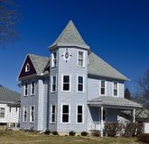 A Gray House. This is a Winter picture of a Gray house located in Bellevue, Iowa in Jackson County.  This wood fram house is an example of Queen Anne Royalty Free Stock Photography