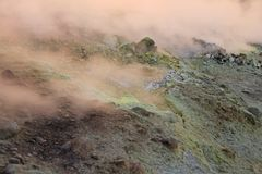Gray Hydrogen Volcano and Volcano Craters on Vulcano Island, Lipari, Italy. Sunset, Gas, Sulfur, Poisonous Pairs, Evaporation.  royalty free stock photo