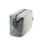 Gray hygienic handbag isolated. Gray hygienic handbag with the zip fastener isolated over the white background royalty free stock images