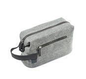Gray hygienic handbag isolated. Gray hygienic handbag with the zip fastener isolated over the white background stock photo