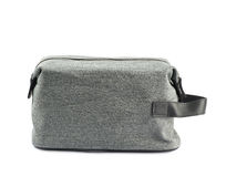 Gray hygienic handbag isolated. Gray hygienic handbag with the zip fastener isolated over the white background stock images