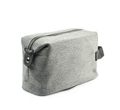 Gray hygienic handbag isolated. Gray hygienic handbag with the zip fastener isolated over the white background royalty free stock photography
