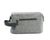 Gray hygienic handbag isolated. Gray hygienic handbag with the zip fastener isolated over the white background royalty free stock photo