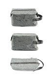 Gray hygienic handbag isolated. Gray hygienic handbag with the zip fastener isolated over the white background, set of three different foreshortenings royalty free stock photos