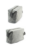 Gray hygienic handbag isolated. Gray hygienic handbag with the zip fastener isolated over the white background, set of two different foreshortenings stock image