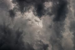 Gray incoming storm clouds dark closeup backdrop. Captured on 100 mm telephoto lens royalty free stock photos