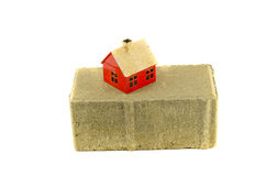 Gray industrial brick and small house model isolated on white Royalty Free Stock Photo