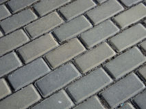 Gray interlocking pavement Stock Photos