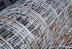 Gray iron wire fence texture in a warehouse. Selective focus and close up Royalty Free Stock Images
