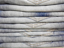 Gray jeans pile in the shop supermarket Royalty Free Stock Photography