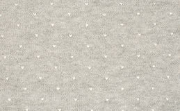 Gray jersey fabric with white stamped hearts Royalty Free Stock Photos