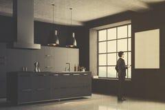 Gray kitchen corner, square window, man Stock Photography