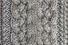 Gray knitted background medium thickness thread royalty free stock image