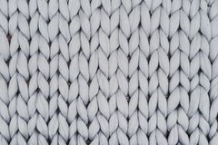 Gray knitted blanket from merino wool royalty free stock image