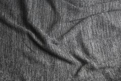 Gray knitted blanket. Soft and warm fabric texture. Copy space. Autumn, fall or winter background. Top view stock images
