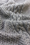 Gray knitted fabric Stock Images