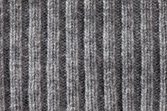 Gray knitted horizontal textured background Stock Photos