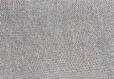 Gray knitted textile texture. Stock Photos