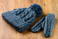 Gray knitting cap and mittens Royalty Free Stock Images