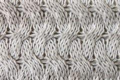 Gray Knitting of Gebreide het Patroonachtergrond van de Stoffentextuur dicht stock afbeeldingen