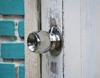 Gray knob on wooden door Royalty Free Stock Photo