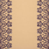 Gray lace on beige paper Stock Image