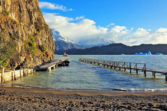 Gray lake and pier Stock Image