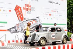 A gray Lancia Ardea arrives at the 1000 Miglia classic car race Royalty Free Stock Image