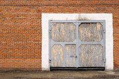 Gray large garage door made of bricks Royalty Free Stock Photo
