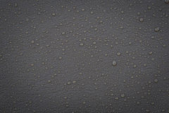 Gray leather with water droplets Royalty Free Stock Images