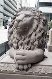 Gray Lion Statue Watching Immagine Stock