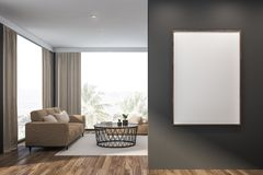Gray living room, beige sofa and poster royalty free stock images