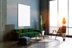 Gray living room corner, green sofa, poster, woman royalty free stock images