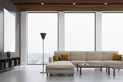 Gray living room iterior. Interior of a living room with a gray wall, tall windows and a white sofa standing near a coffee table. 3d rendering Stock Photo