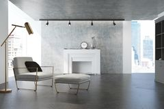 Gray living room, white armchair, fireplace Stock Image