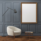 Gray living room, white armchair, poster Royalty Free Stock Photography