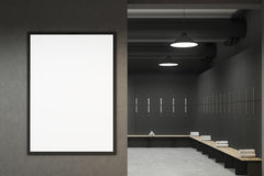 Gray locker room with a poster. Front view of a gray locker room with benches along the rows of lockers. There is a vertical framed poster on a wall. 3d Royalty Free Stock Images