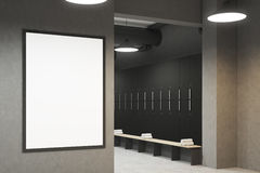 Gray locker room with a poster, side. Side view of a gray locker room with benches along the rows of lockers. There is a vertical framed poster on a wall. 3d Royalty Free Stock Images