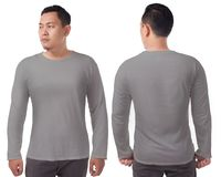 Grey Long Sleeved T-Shirt Template. Gray long sleeved t-shirt mock up, front and back view, isolated. Male model wear plain grey shirt mockup. Long sleeve shirt stock photo