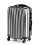 Gray luggage with three handles and four wheels. Modern gray luggage with three handles and four wheels Stock Photos