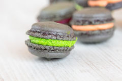 Gray macaroons with colorful cream Royalty Free Stock Images