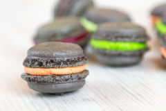 Gray macaroons with colorful cream Stock Photo