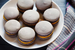 Gray macaroons on plate Royalty Free Stock Photography