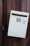Gray mailbox on  old woodendoor Stock Image