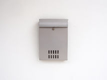 Gray mailbox. On white wall Royalty Free Stock Photos