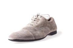 Gray man's shoe  Stock Photos