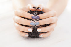 Gray manicure with a black ball of yarn royalty free stock photos