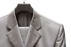 Gray men's suit. Business gray men's suit on peg isolated on white Royalty Free Stock Image