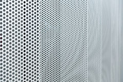 Gray metal background, round perforated metal texture Royalty Free Stock Image